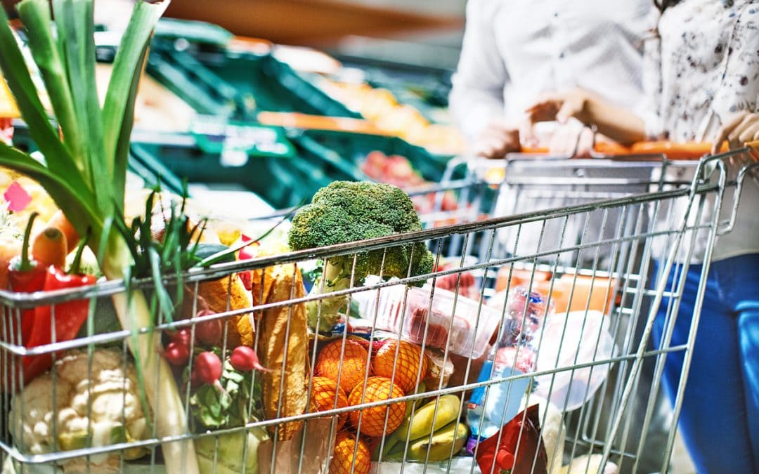 Healthy Benefits Plus couple shopping for fresh produce.